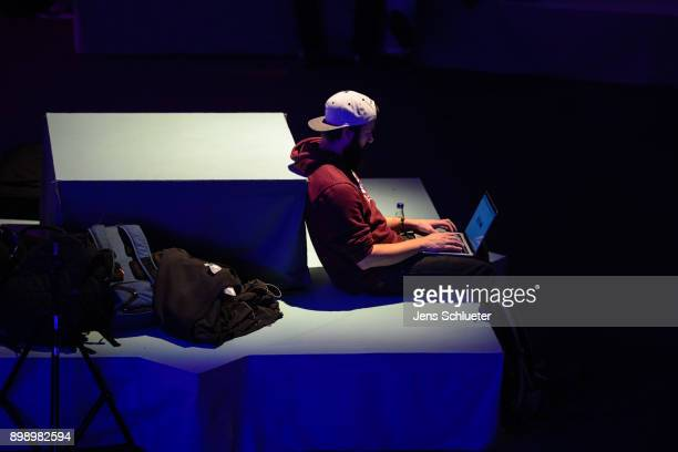 A participant attends the 34C3 Chaos Communication Congress of the Chaos Computer Club on December 27 2017 in Leipzig Germany The annual congress...