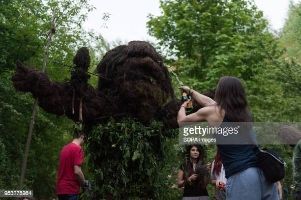 A participant attends the Beltane feast of Fire next to Krakau Mound in Krakow The Beltane Fire Festival is an annual participatory arts event held...