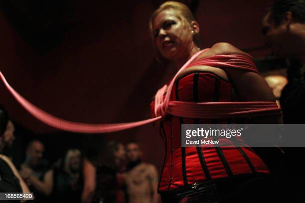 A participant called SgChill is bound in rope at a dungeon party during the domination convention DomConLA in the early morning hours of May 11 2013...