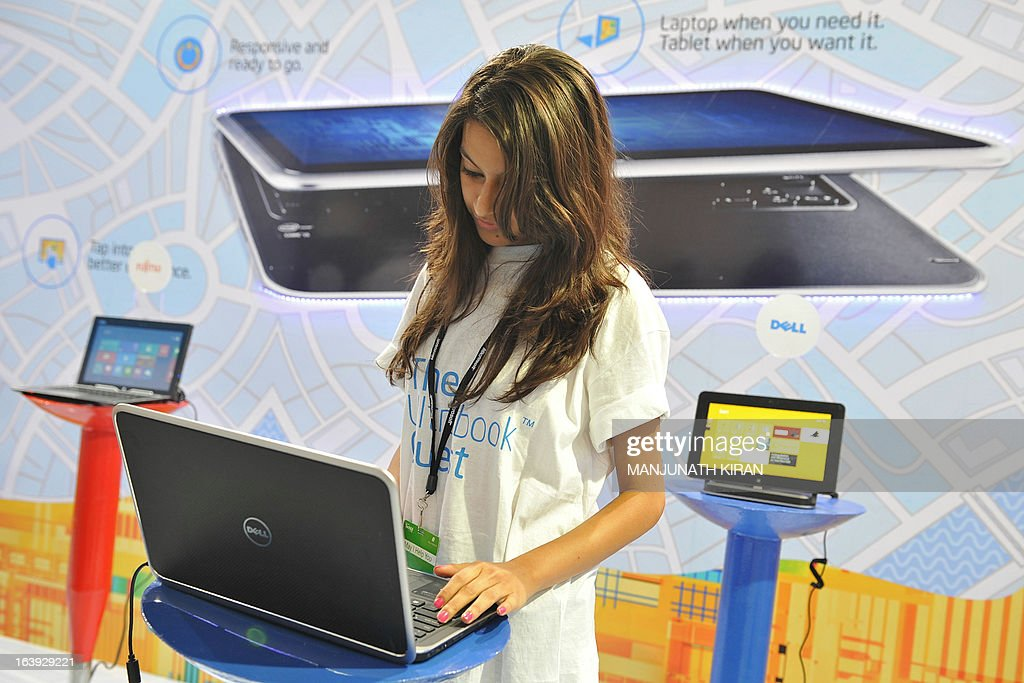 A participant checks out a laptop at an exhibition stall during the TechEd 2013 technology event in Bangalore on March 18, 2013