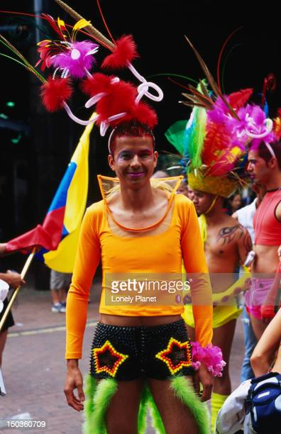 Participant colourfully dressed during parade at London Pride.