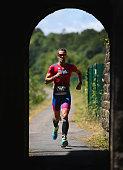bolton england participant competes run leg
