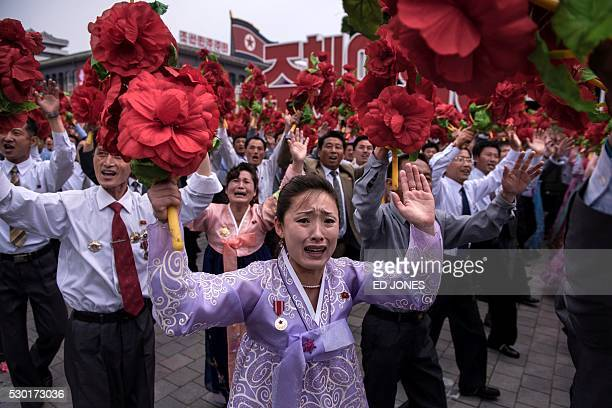 TOPSHOT A participant cries as she takes part in a mass parade marking the end of the 7th Workers Party Congress in Kim IlSung square in Pyongyang on...
