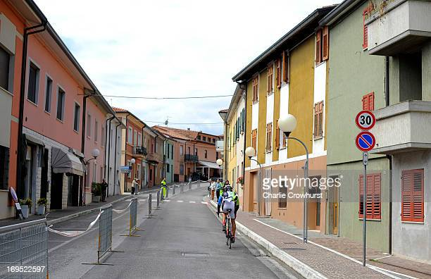 Participant cycles through a small town during the Challenge Family Triathlon Rimini on May 26 2013 in Rimini Italy
