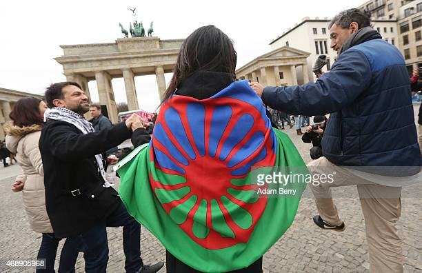 A participant dances with a Romani flag at a proRomani demonstration in front of the Brandenburg Gate on International Romani Day on April 8 2015 in...