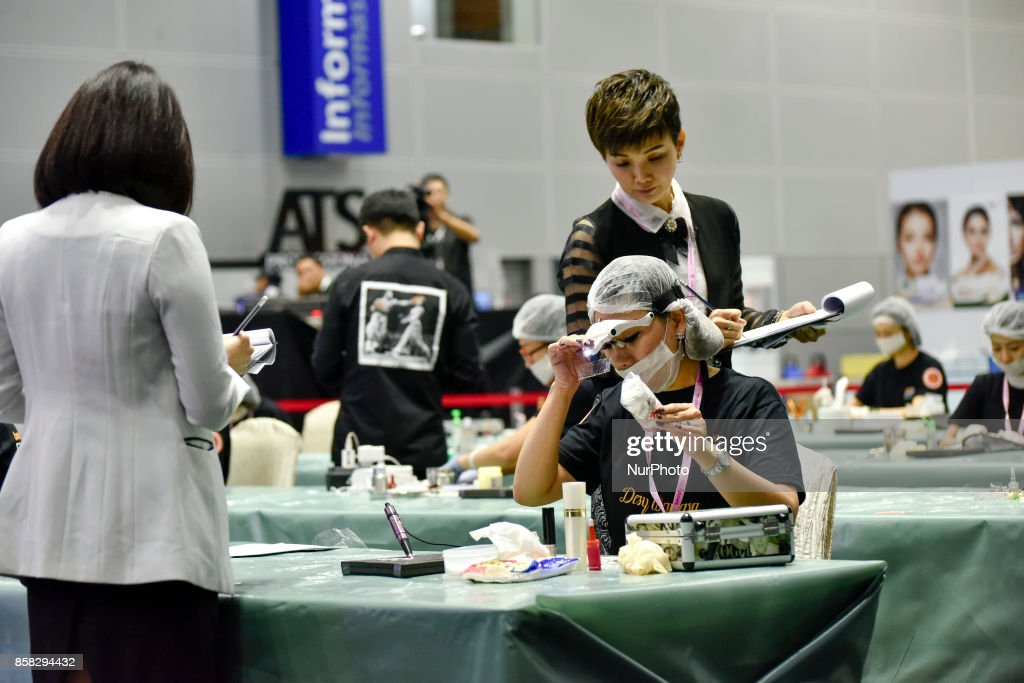 Participant Desy Kasim(C, Indonesia) in action during the Malaysia International Embroidery Competition, called Beautyface Embroidery on October 6, 2017 at Kuala Lumpur Convention Centre, Malaysia.
