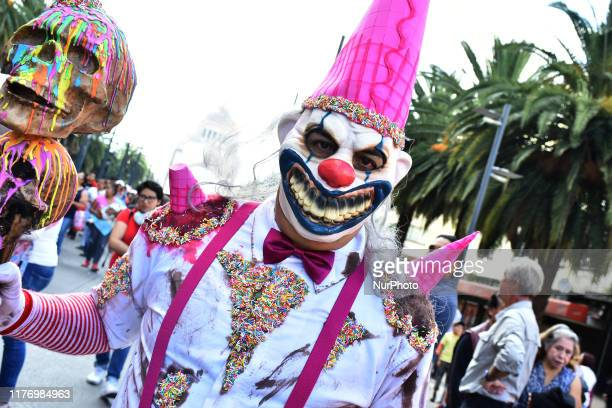 A participant disguised as clown is seen taking part during the march of annual Zombie Walk at Monumento of Revolucion on October 19 2019 in Mexico...