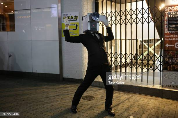 A participant dress up as a character 'Movie theaf' on the Halloween weekend in Shibuya district on October 28 2017 in Tokyo Japan