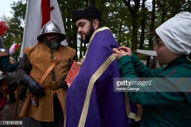 A participant dressed as a bishop of the Spanish army prepares on October 18 2019 in Groenlo Netherlands For three days the streets of the village of...