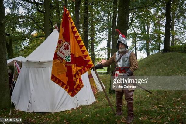 A participant dressed as a standardbearer of the Spanish army poses on October 18 2019 in Groenlo Netherlands For three days the streets of the...