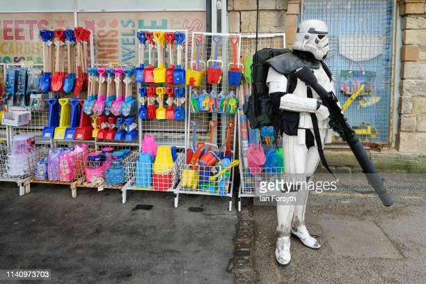 Participant dressed as a Stormtrooper stands outside a gift shop on the second day of the Scarborough Sci-Fi weekend held at the seafront Spa Complex...