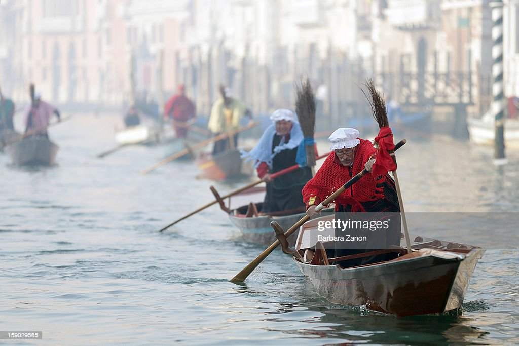 A participant dressed as 'Befana' rows on Gran Canal during the traditional Epiphany Boat Race on January 6, 2013 in Venice, Italy. In Italy, Epiphany is celebrated on January 6, and on the canal mascareta boats are piloted in tribute to 'Befana', a witch who delivers gifts and sweets to children.