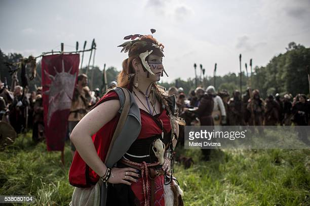 A participant dressed as character from 'The Hobbit' book by J R R Tolkien prepares for the reenactment of the 'Battle of Five Armies' in a forest on...