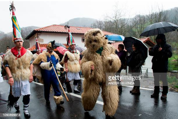 A participant dressed as 'Hartza' parades with bellringers known as 'Joaldunak' in Basque with big cowbells hanging on their backs during...