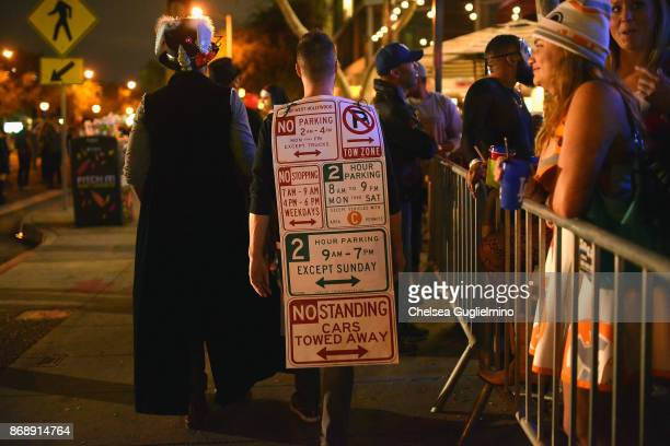 A participant dressed as Los Angeles parking signs at the West Hollywood Halloween Carnaval on October 31 2017 in West Hollywood California