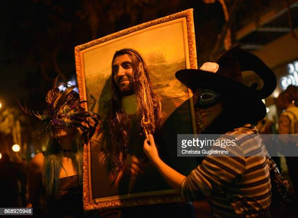A participant dressed as Mona Lisa at the West Hollywood Halloween Carnaval on October 31 2017 in West Hollywood California