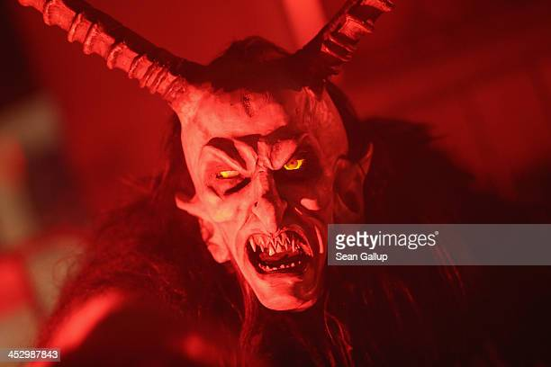 A participant dressed as the Krampus creature walks the streets in search of delinquent children during Krampus night on November 30 2013 in Neustift...