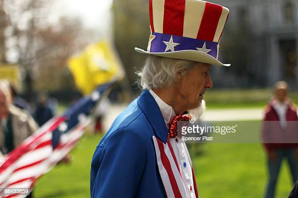 A participant dressed as Uncle Sam attends a Tea Party Express rally on April 13 2010 in Albany New York The Tea Party Express will head to Boston on...