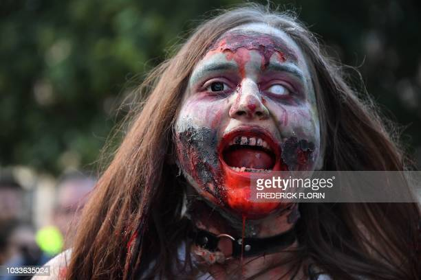 A participant dressed as zombie takes part in the Zombie Walk event on September 15 2018 in the eastern French city of Strasbourg within the...