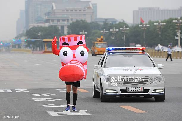 A participant dressed himself poses on road during the 2016 Beijing Marathon on September 17 2016 in Beijing China Running from the Tian'anmen Square...