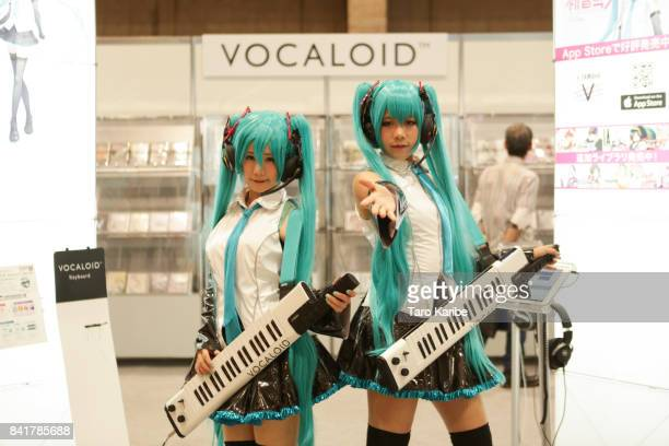 Participant dressed in Hatsune Miku cosplay costumes pose for portraits on September 1 2017 in Chiba Japan Hatsune Miku singing voice synthesizer...