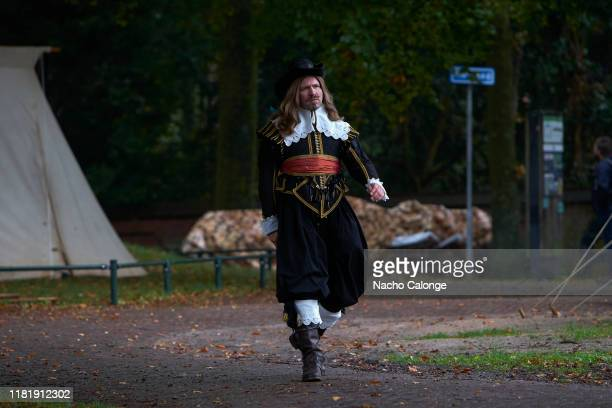 A participant dressed in seventeenth century costume on October 18 2019 in Groenlo Netherlands For three days the streets of the village of Groenlo...