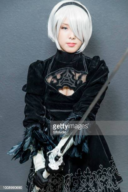 A participant dresses in a Cosplay outfit as she attends the 20th AniCom and Games Fair 2018 at the Hong Kong Convention and Exhibition Centre on...