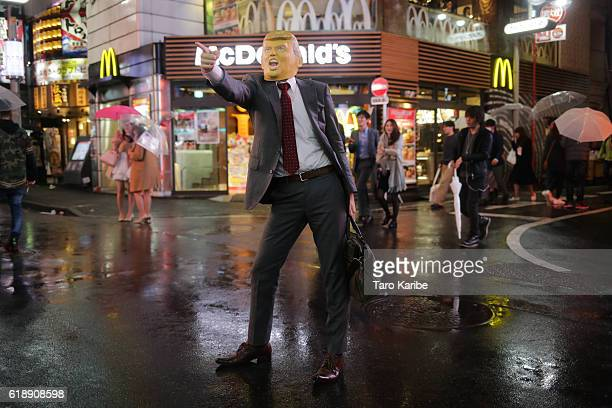 A participant dresses up as a Donald Trump for Halloween on October 29 2016 in Shibuya Tokyo Japan