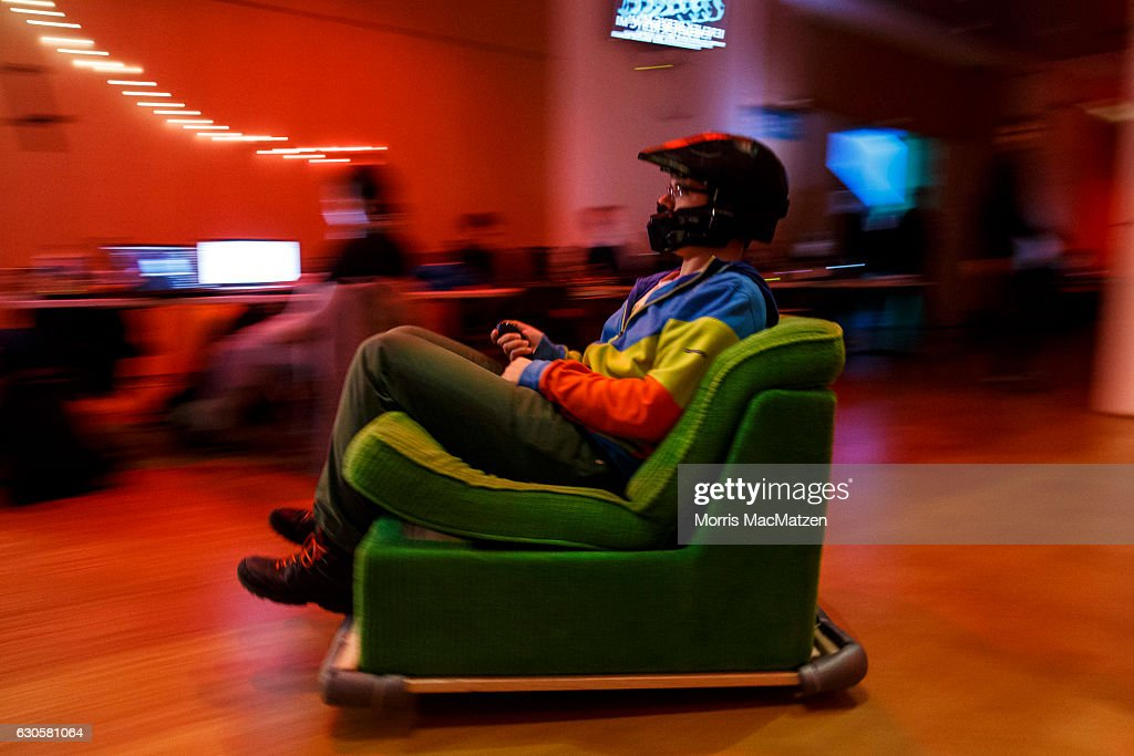 A participant drives his mobile chair during the 33rd Chaos Communication Congress on its opening day on December 27, 2016 in Hamburg, Germany. The annual event is bringing together 12,000 computer hackers and activists who will meet over the next four days to share expertise and discuss topics related to the society and the digital world.