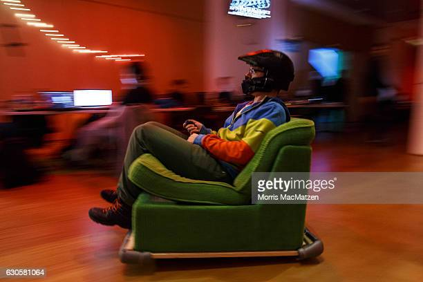 A participant drives his mobile chair during the 33rd Chaos Communication Congress on its opening day on December 27 2016 in Hamburg Germany The...