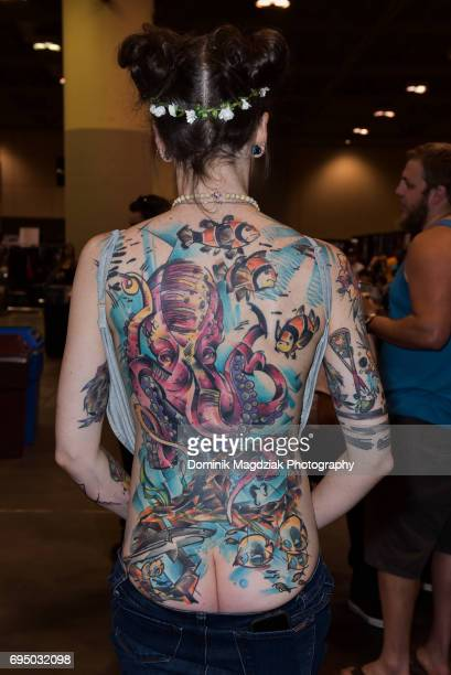 "Participant enters the tattoo contest for best back piece during day three of the ""19th Annual Northern Ink Xposure Tattoo Convention"" at the Metro..."