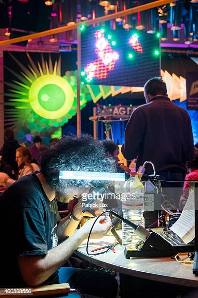 A participant examines a piece of a computer at the 31st annual Chaos Communication Congress on December 28 2014 in Hamburg Germany The annual...