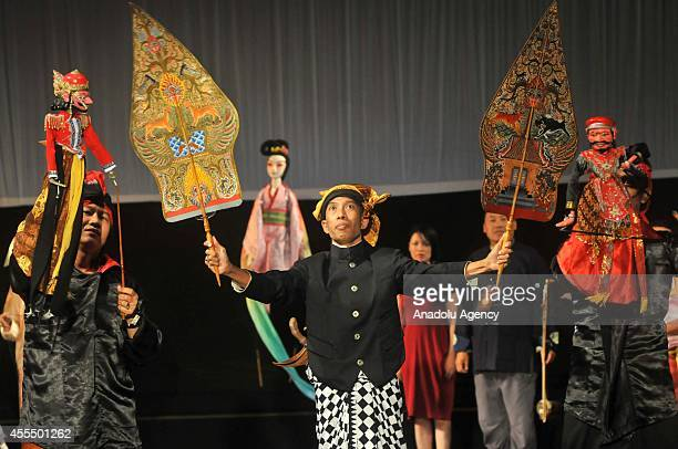 A participant from Indonesia performs at Traditional Performing Arts of Puppet Performance 2014 organized with the collaboration of ASEANChina in...