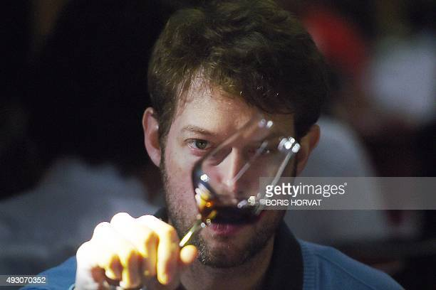A participant from South Africa looks at a wine during the World Blind Wine Tasting Championships gathering 80 participants representing 20 countries...