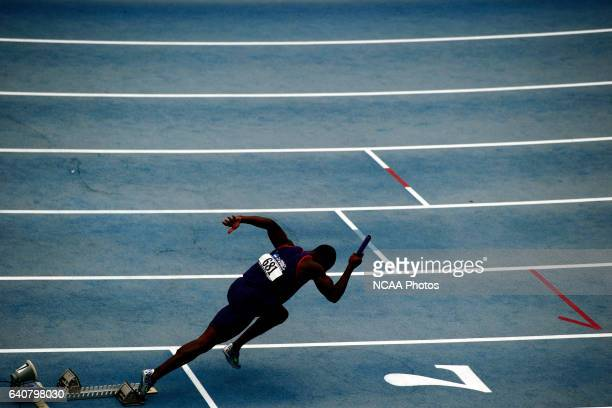 A participant gets off to a fast start of the men's 4X100 meter race during the Division I Men's and Women's Outdoor Track and Field Championship...