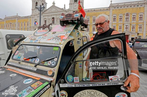 Participant gets out of his car on the parking area in Mafra after the parade of Citroen classic cars 2CV during the World 2017 2CV Meeting July 30,...