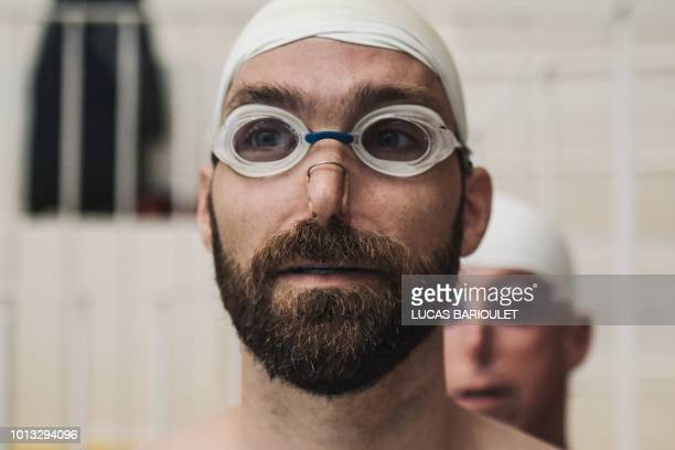 A participant gets ready for the synchronized swimming contest during the 10th edition of the international Gay Games at the Maurice Thorez swimming...