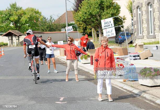 A participant grabs somehing from the aid station during the Challenge Triathlon Vichy on September 01 2013 in Vichy France