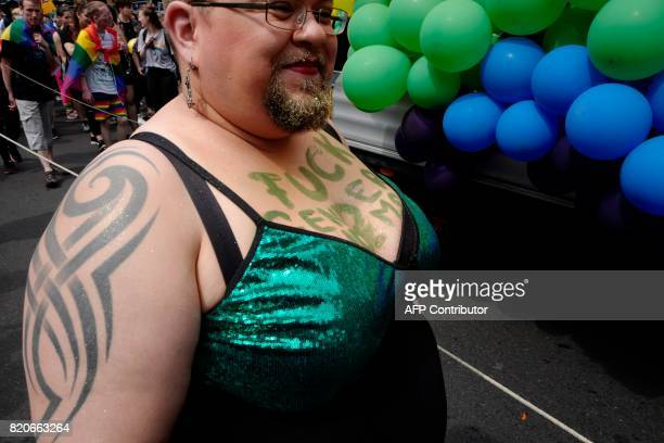 A participant has 'Fuck gender norms' written on his/her chest during Berlin's annual Christopher Street Day gay pride parade on July 22 2017 Gays...