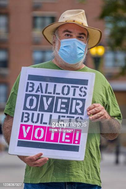 Participant holding a Ballots Over Bullets, VOTE! sign at the protest. Gays Against Guns , the direct action, gun violence prevention group formed by...