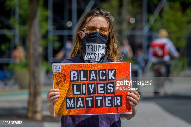 Participant holding a Black Lives Matter sign at the protest. Gays Against Guns , the direct action, gun violence prevention group formed by members...
