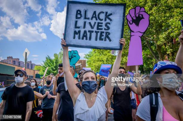 A participant holding a Black Lives Matter sign at the protest Thousands of New Yorkers joined the Coalition to Honor Black and Indigenous Activists...