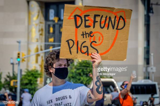 A participant holding a Defund The Pigs sign at the protest Thousands of New Yorkers joined the Coalition to Honor Black and Indigenous Activists at...