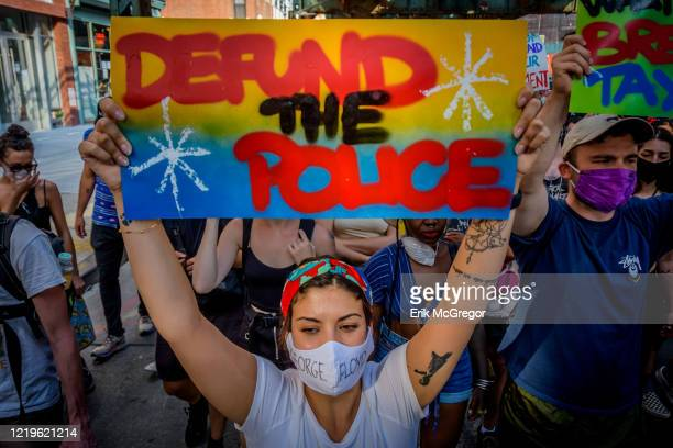 Participant holding a Defund The Police sign at the protest. Hundreds of Brooklynites joined Democratic candidate for U.S. House New York District 7,...