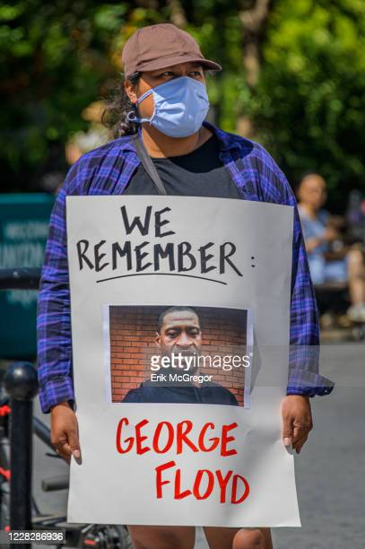 Participant holding a George Floyd sign at the protest. Gays Against Guns , the direct action, gun violence prevention group formed by members of...