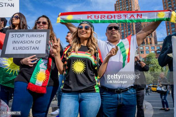 Participant holding a Kurdistan scarf at the Save Rojava rally. Members of the Kurdish community and their allies gathered on the south side of Union...