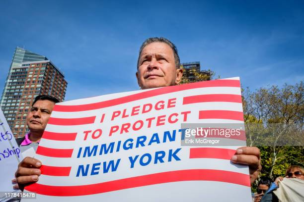Participant holding a protest sign at the rally Immigration advocates and allies gathered at Battery Park to launch an 18day march to Washington DC...