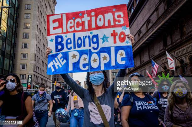 Participant holding a sign at the celebratory march. Thousands of New Yorkers joined members of the Protect the Results: New York City Coalition, a...