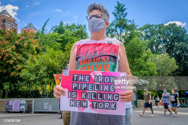 Participant holding a sign at the protest. Gays Against Guns , the direct action, gun violence prevention group formed by members of LGBTQ...