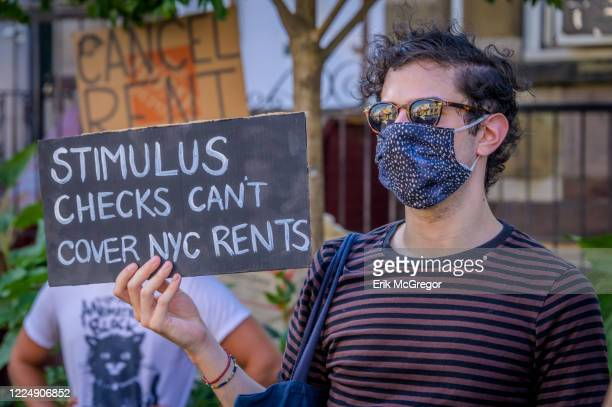 Participant holding a sign at the protest. Tenants and Housing Activists gathered at Maria Hernandez Park for a rally and march in the streets of...